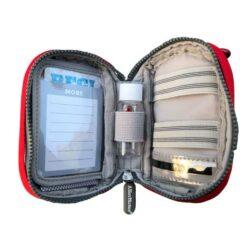 red asthma inhaler case inside